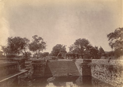 General view of tank with unidentified temple beyond, Rameswaram.
